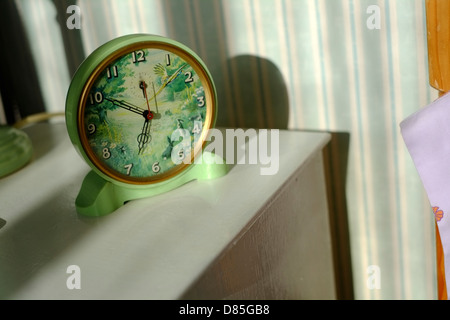 A vintage Smith Sectric alarm clock in the early morning sun.