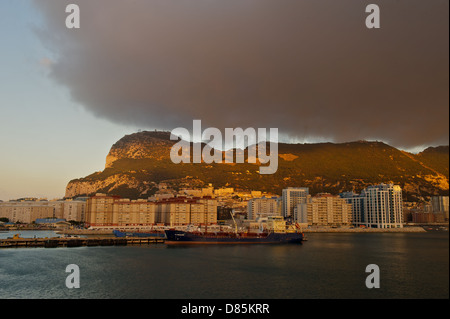 The Rock of Gibraltar at sunset on a stormy evening - Stock Photo