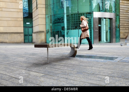 A woman walking past the Laing Art Gallery in the centre of Newcastle Upon Tyne - Stock Photo