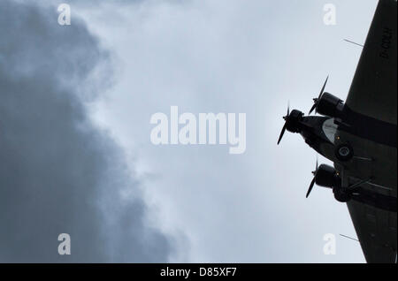A Ju-52 aircraft oldtimer is pictured in flight over Frankfurt Main, Germany, 20 May 2013. Dark rainclouds are seen - Stock Photo