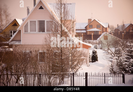 Country house (dacha) in winter dawn - Stock Photo