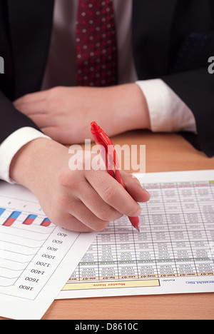 Businessman with financial documents - Stock Photo