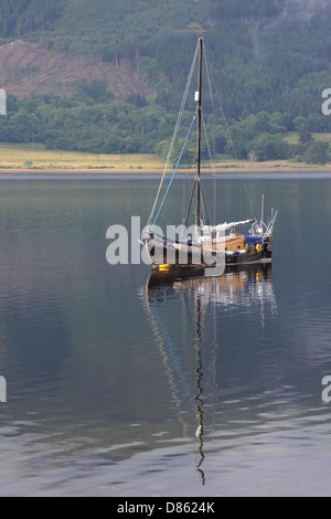 Yacht at anchor on Loch Leven in Scotland. - Stock Photo