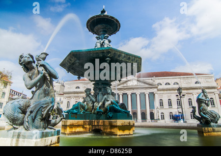 Baroque fountain on rossio square the liveliest in Lisbon. - Stock Photo