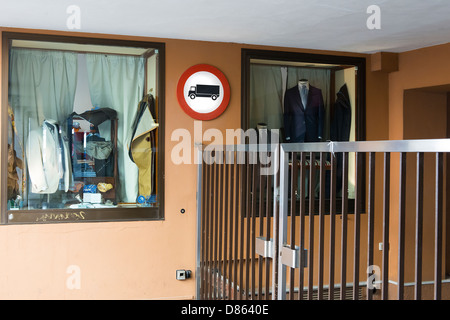 entrance gate  with sign of prohibition of transit to trucks - Stock Photo