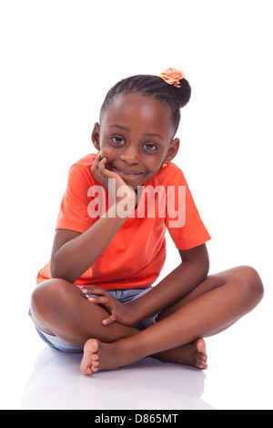 Cute little african american girl sitting on the floor - Black children , isolated on white background - Stock Photo