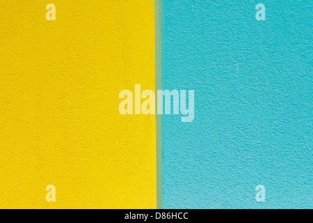Wall of blue and yellow textured paint - Stock Photo