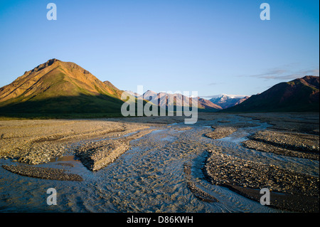 Sunset over the braided Toklat River, Denali National Park, Alaska, USA - Stock Photo