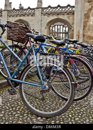 Bicycles parked in front of Cambridge University building, UK - Stock Photo