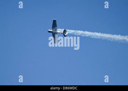 A T-6 Texan aircraft performing during airshow. - Stock Photo