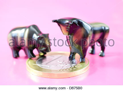Close-up of statues of bull and bear on one Euro coin - Stock Photo