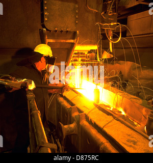 Steelworker Enabling Flow of Molten Steel into Tundish above Continuous Casting Plant Rotherham Engineering Steels - Stock Photo