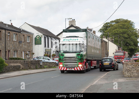 Eddie Stobart truck 5926 'Orla Grace' with a curtain-sided trailer passing through the village of Shap in Cumbria - Stock Photo