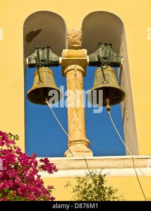 Monastry front architectural element and bells near Paleokastristas, Corfu Island, Greece - Stock Photo