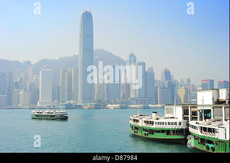 Ferry from Kowloon to Hong Kong island - Stock Photo