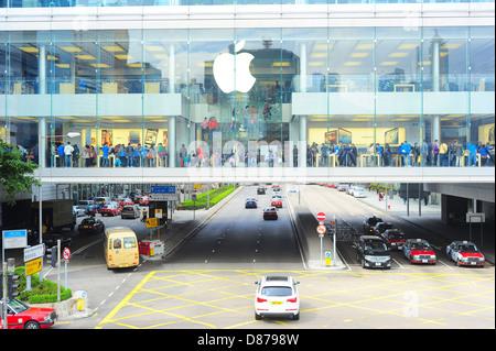 Customers at Apple store in Hong Kong - Stock Photo
