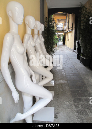 Mannequins in a row in alleyway in Corso Como Milan Italy - Stock Photo