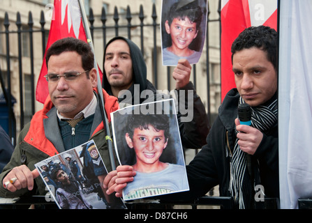Bahraini protesters outside Downing Street in London accusing UK government of supporting Bahrain tyranny - Stock Photo