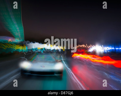 Corvette Car Speeding On Highway At Night - Stock Photo
