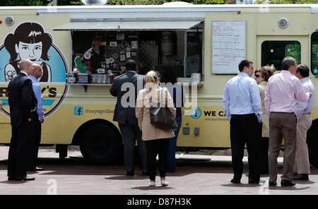 Office workers on lunch break at food truck in downtown Boston Massachusetts - Stock Photo