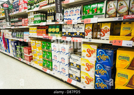 Lager / beer aisle in a Sainsburys supermarket, England, UK - Stock Photo