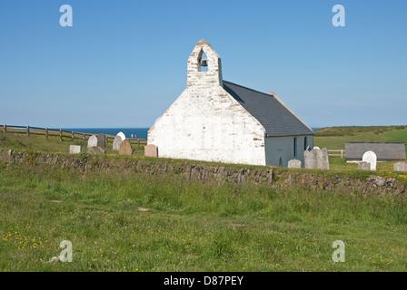 The isolated 14th century Holy Cross Church on the coast at Mwnt near Cardigan, Ceredigion, west Wales, United Kingdom - Stock Photo