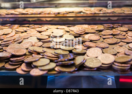 Close up of 2p pieces in an amusement arcade penny falls machine game, UK - Stock Photo