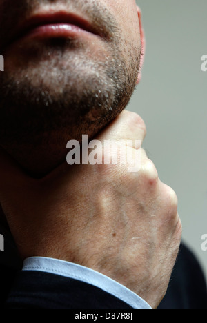 Hand on throat - Stock Photo