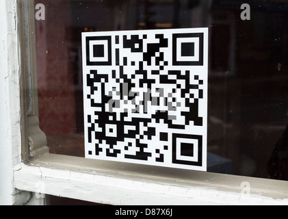 QR code on a window of a shop - Stock Photo