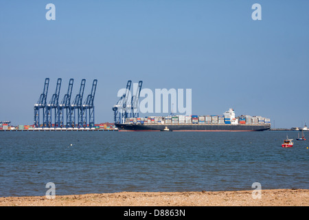 A container ship enters the port of Felixstowe, viewed from Harwich - Stock Photo