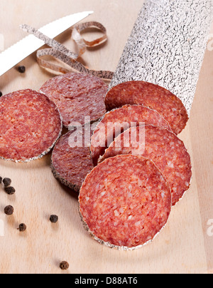 Slices of the winter sausage - Stock Photo