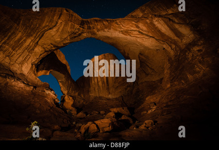 Double Arch in Arches National Park, Utah as seen at night. The arch was light-painted using a large, xenon flashlight. - Stock Photo