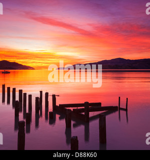 Beautiful sunset with colours of red, orange and yellow, over Governors Bay, Canterbury New Zealand, looking towards - Stock Photo