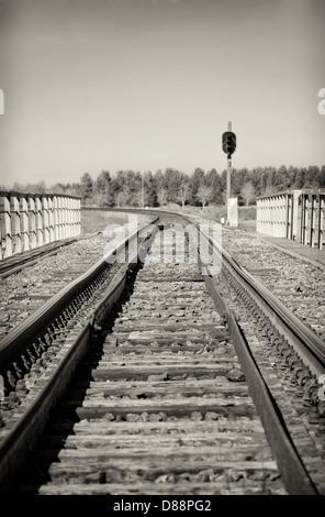 Empty railroad track with semaphore signal. Black and white. - Stock Photo