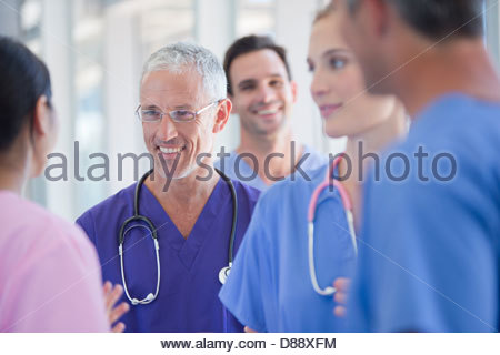 Smiling doctors and nurses - Stock Photo