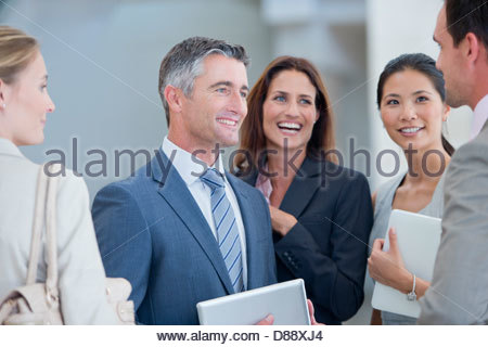 Happy business people talking - Stock Photo