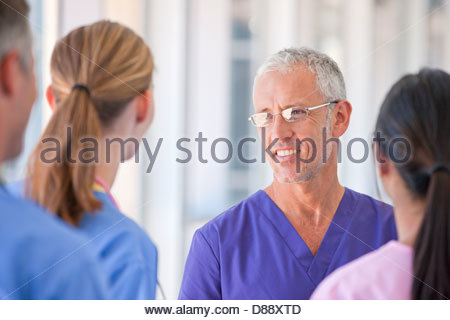 Close up of doctors and nurse talking - Stock Photo