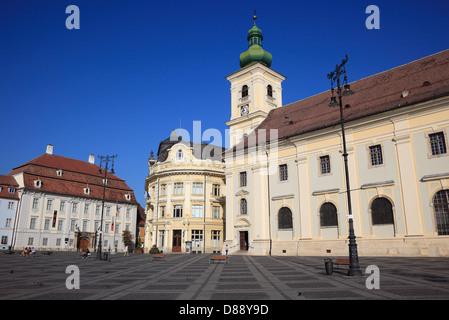 Brukenthal Palace, left, City Hall, Catholic garrison church, on the Grand Boulevard, Piata Mare, Sibiu, Romania - Stock Photo
