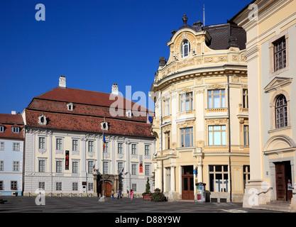 Brukenthal Palace, left. City Hall, on the Grand Boulevard, Piata Mare, Sibiu, Romania - Stock Photo