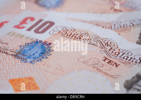 Ten pound notes spread out on a table. - Stock Photo