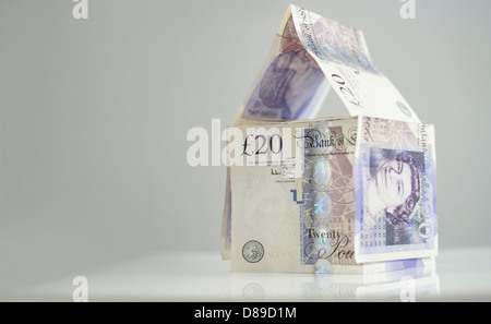 Property Investment. A house made of twenty pound notes. - Stock Photo