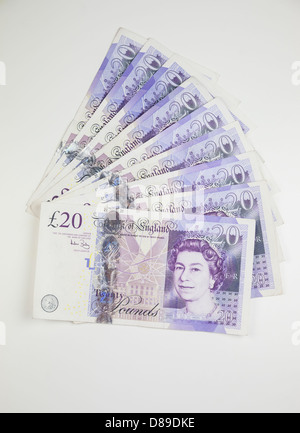Twenty pound notes in a fan shape on a table - Stock Photo