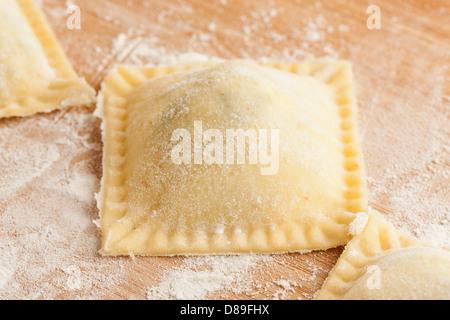 Fresh Homemade Ravioli against a back ground - Stock Photo