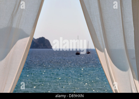White curtains window view to sea and boats. Summer abstraction, focus on the drapes. - Stock Photo