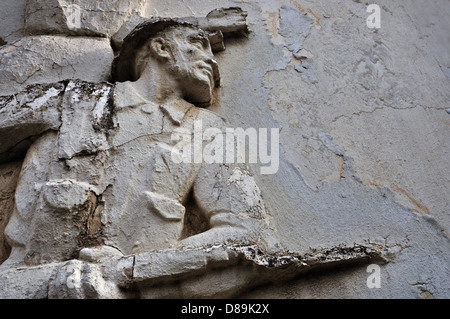 Soldier with broken bayonet on weathered wall exterior. - Stock Photo
