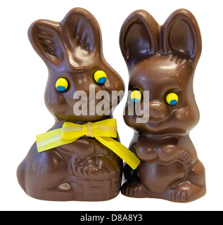 Chocolate Happy Easter Day Bunny Rabbit Pair with Yellow Ribbon Bow Isolated on White Background - Stock Photo