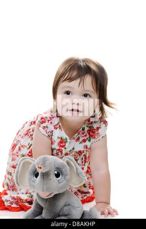Young female toddler with fluffy toy - Stock Photo