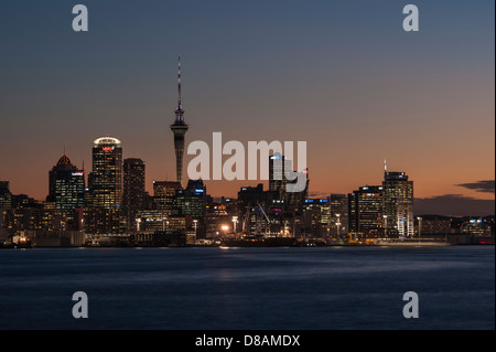 Downtown Auckland harbour and skyline including CBD and Sky Tower photographed from Devonport early evening.  New - Stock Photo