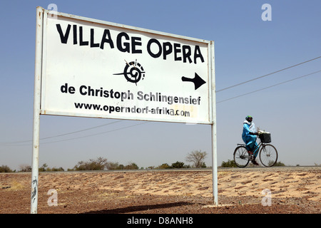 sign to the Opera Village of the film director and theater director late in 2010 Christoph Schlingensief. - Stock Photo