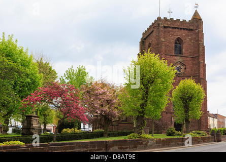 14th century Norman parish church of St Nicholas built in red sandstone with clock tower dating to 1309 in Newport - Stock Photo